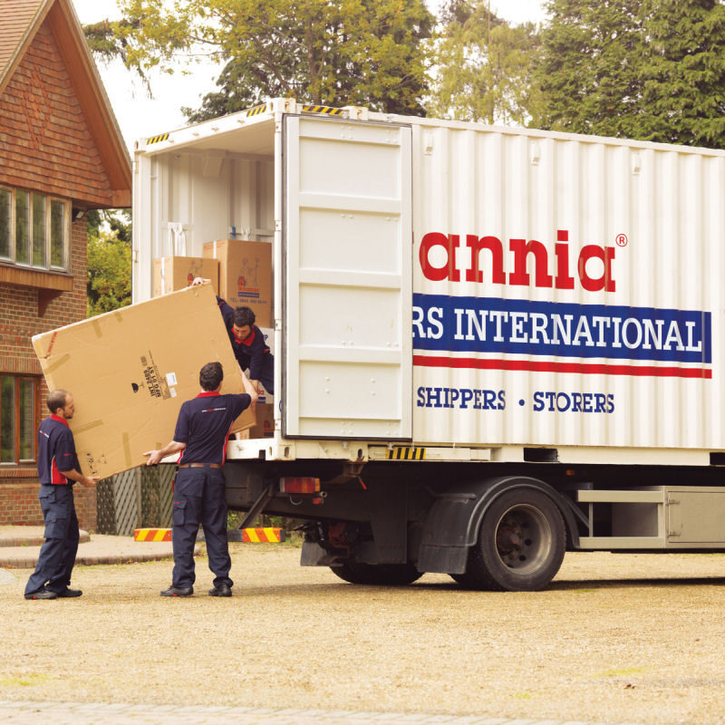 Britannia crew unloading goods from large removal truck