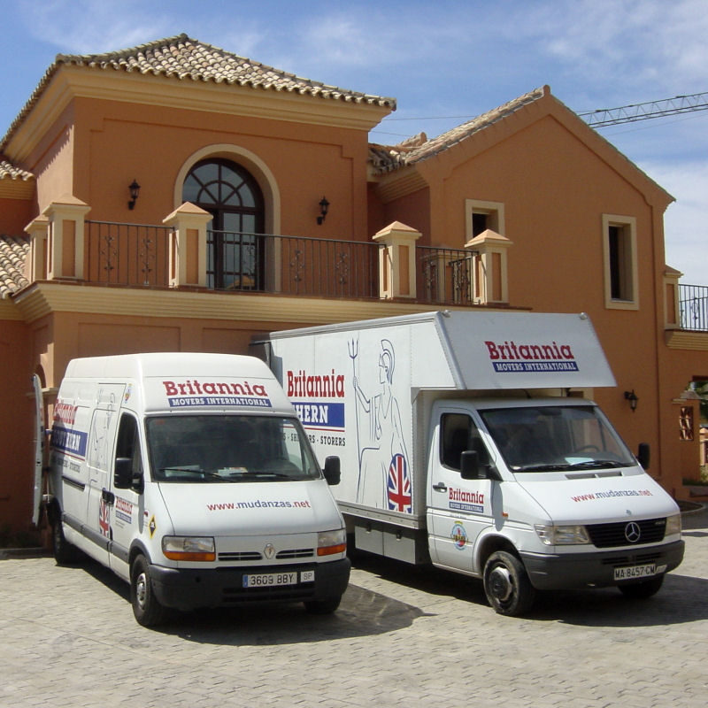 Two Britannia removal vans outside a villa in Spain
